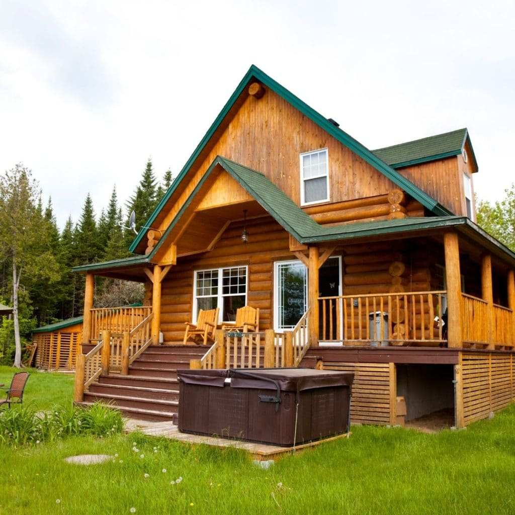 Huge log cabin home with a big porch.