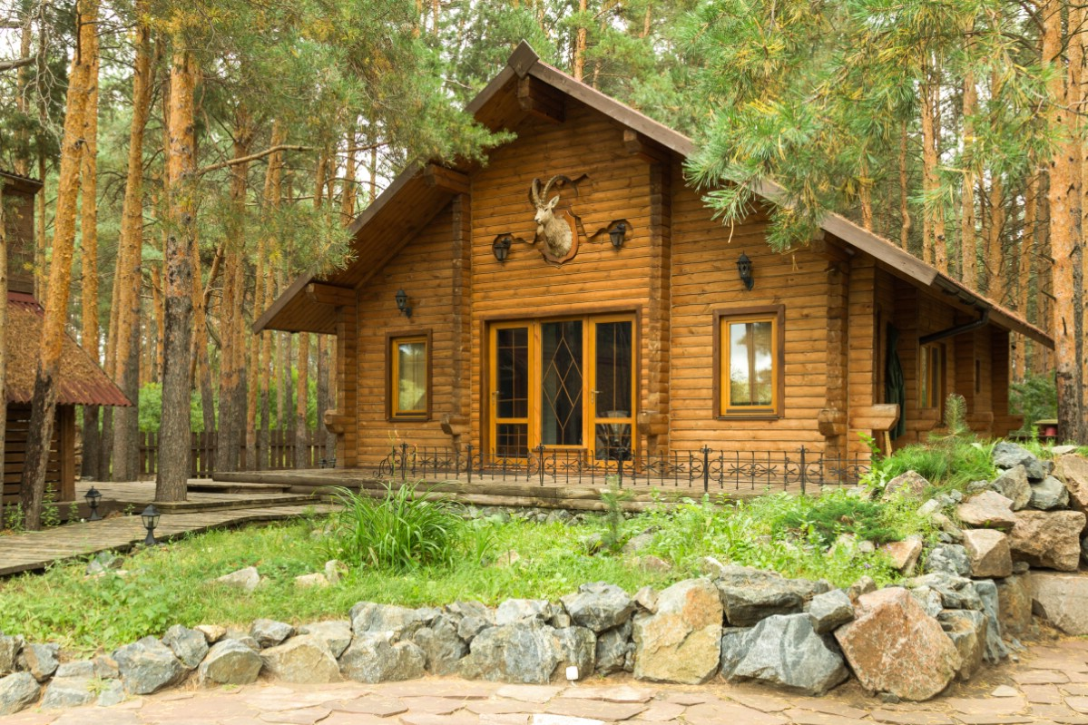 Finished log cabin house in the nature.