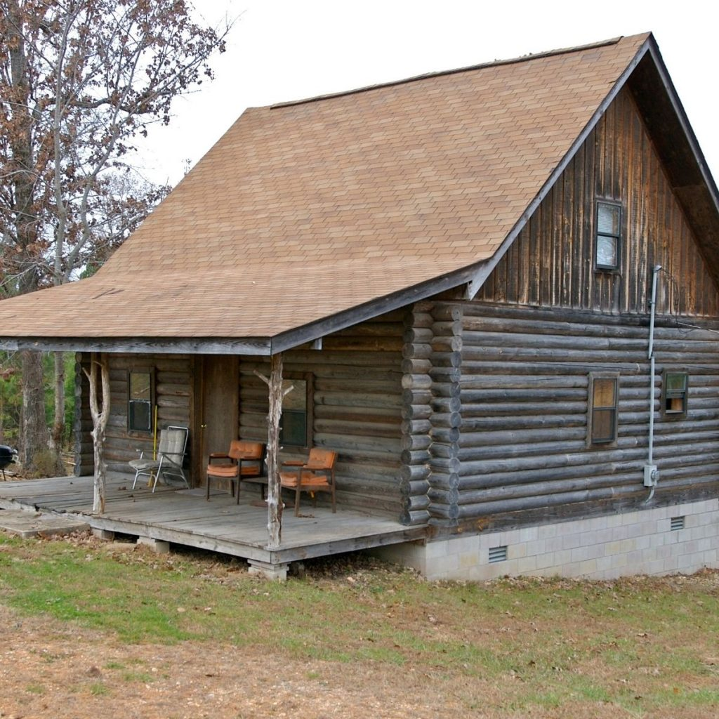Simple log cabin with a porch.