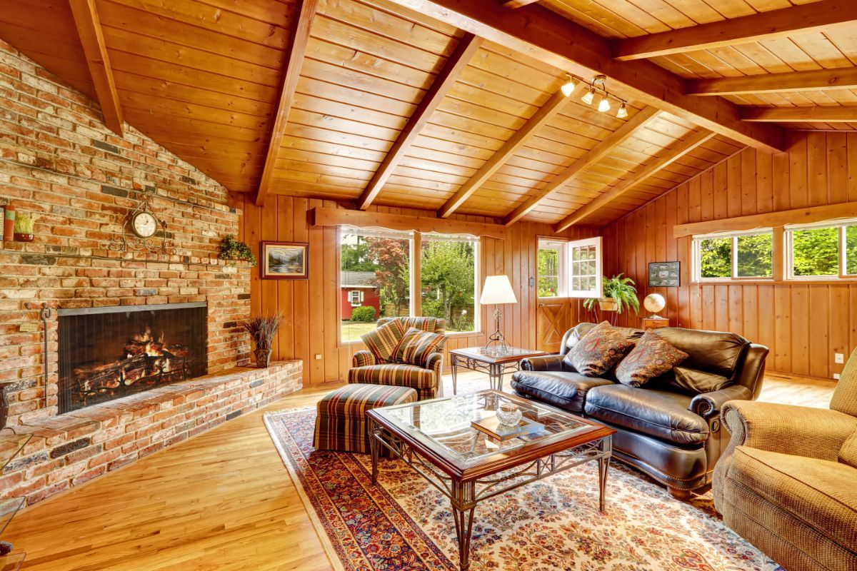 log cabin interior with couch and fireplace