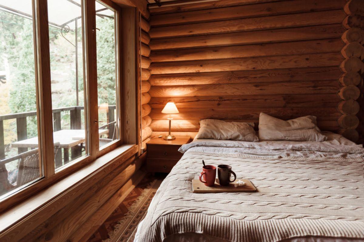 Glass Cabin Window of log bedroom
