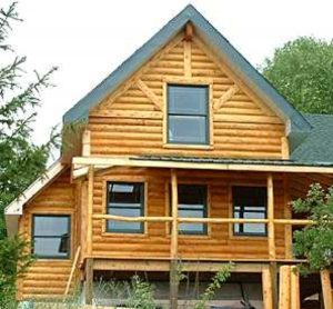 big log home surrounded by trees
