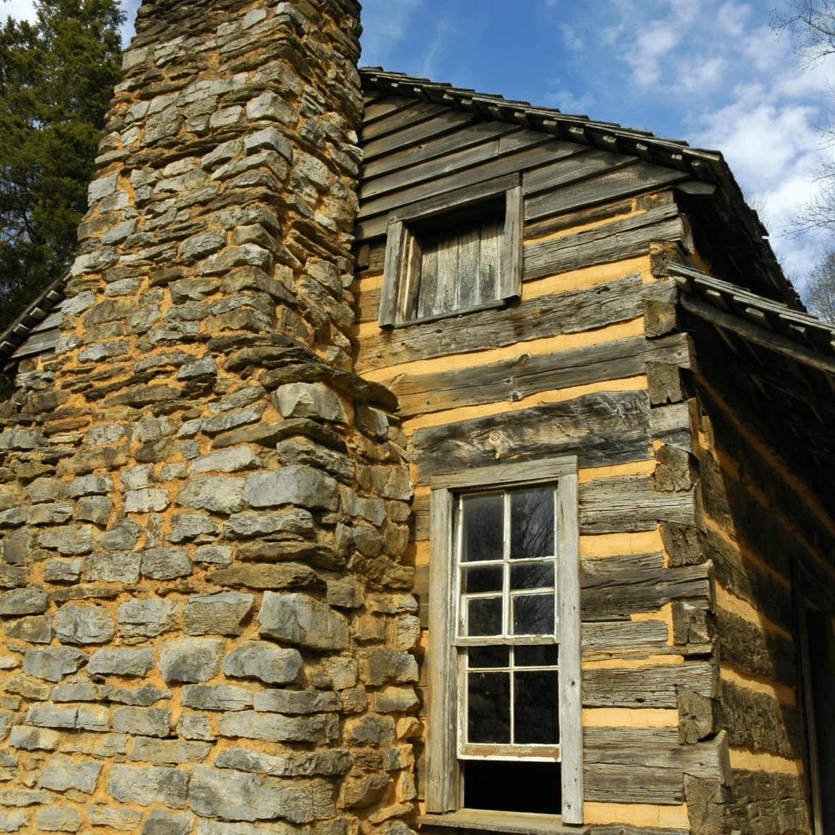 close up of a small window in a log cabin