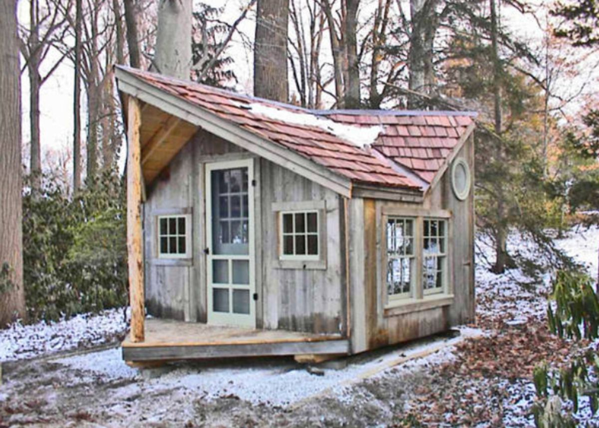 small log cabin in snowy woods