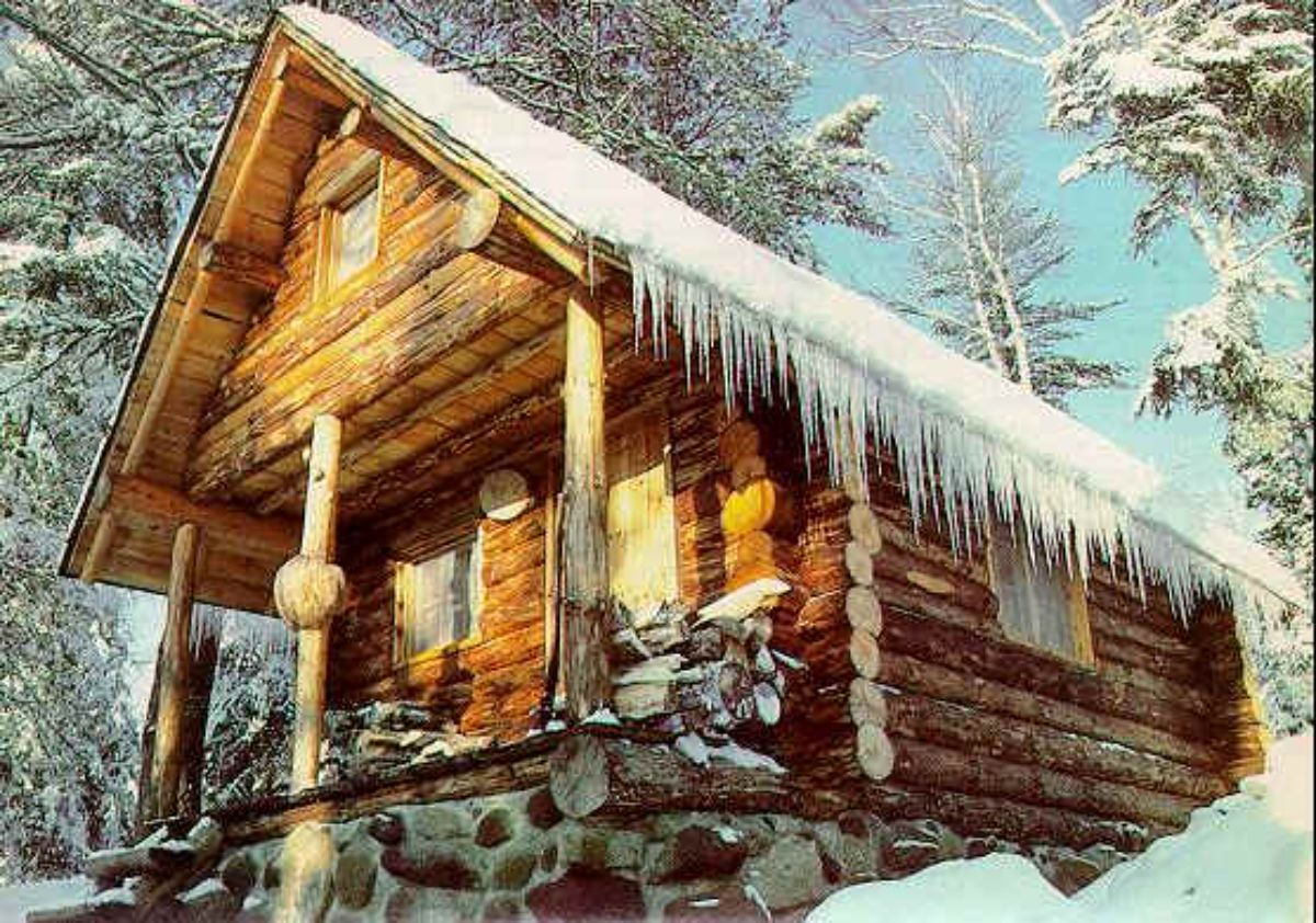 Log cabin covered with ice