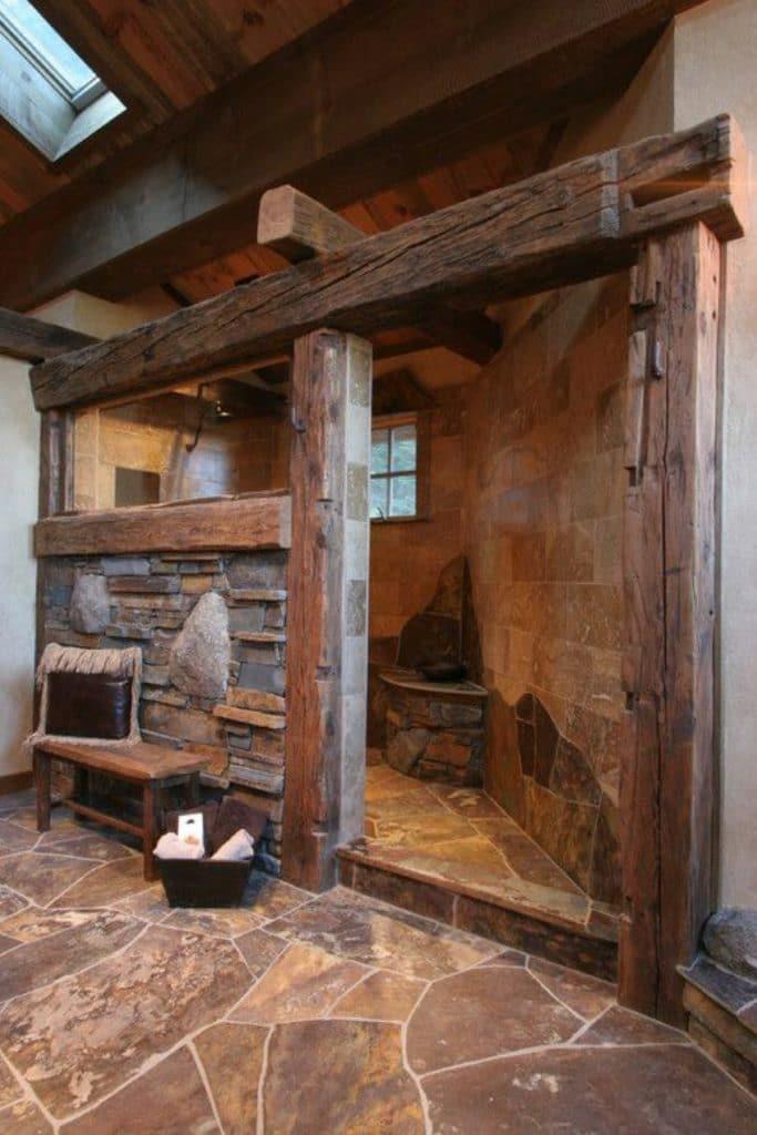 Rustic tone shower in a log cabin.