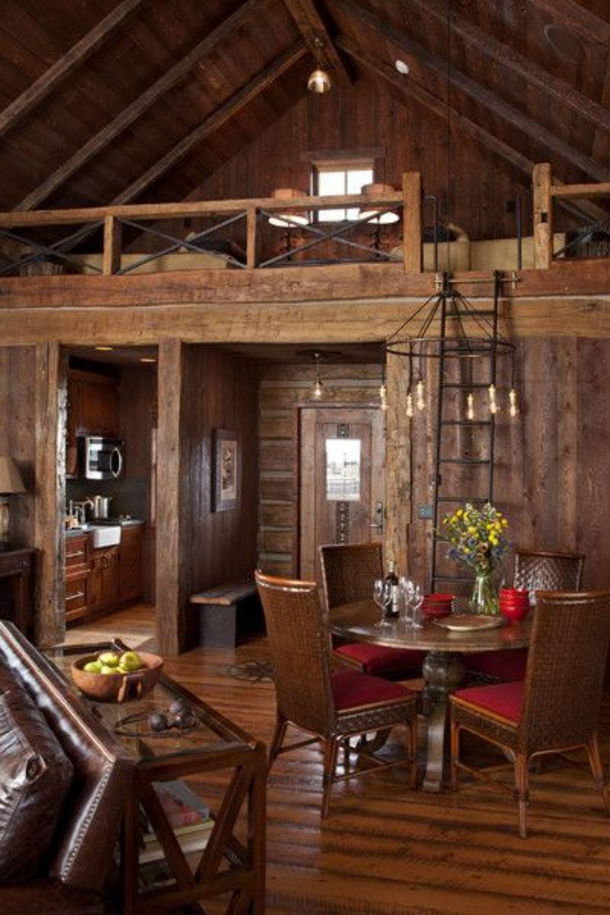Log room with metal ladder