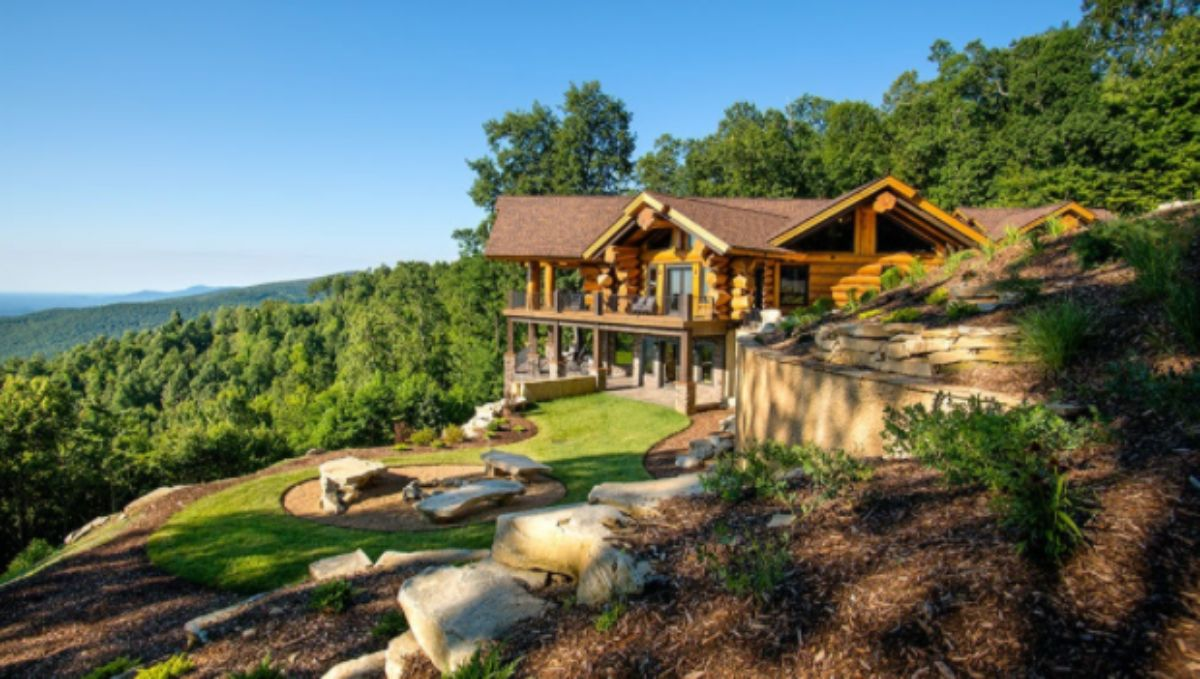 giant log home on a slope