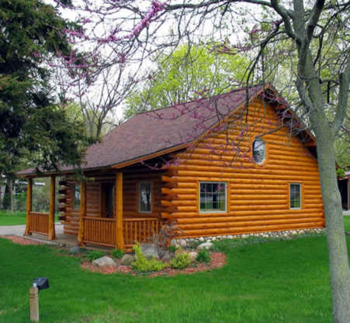 small log cabin surrounded by greenery