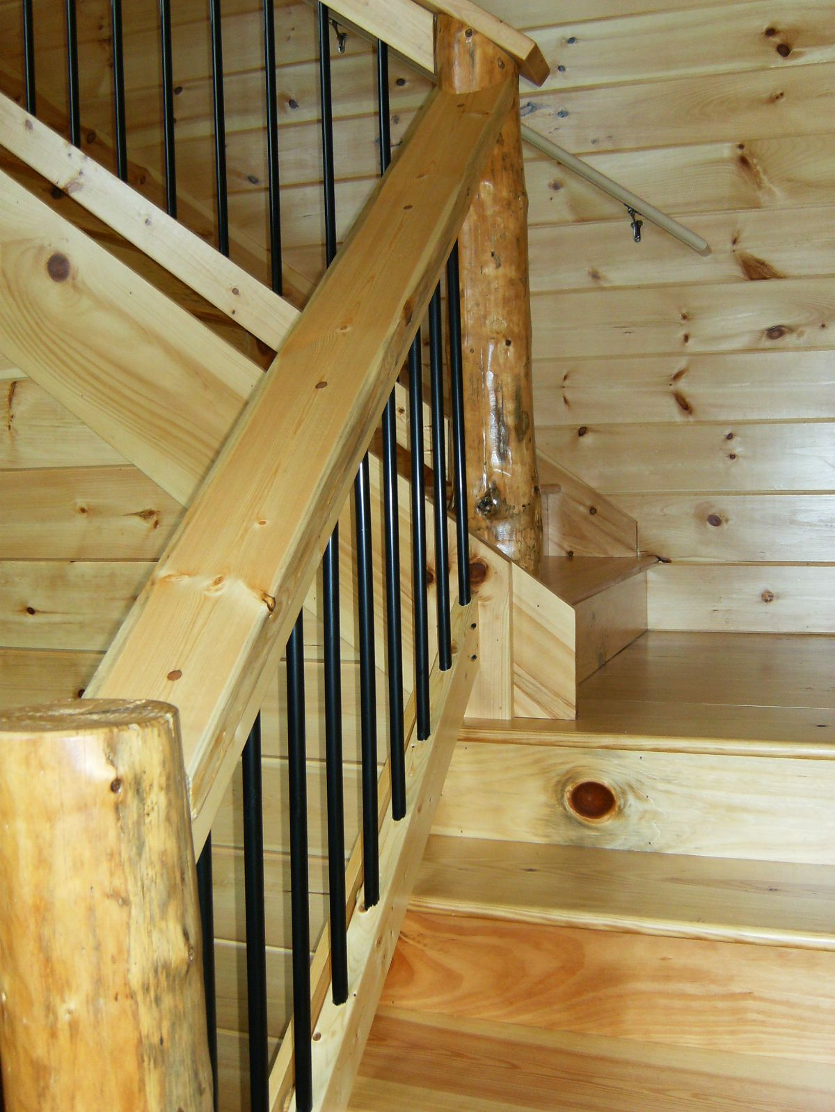 Log stairs with iron rods