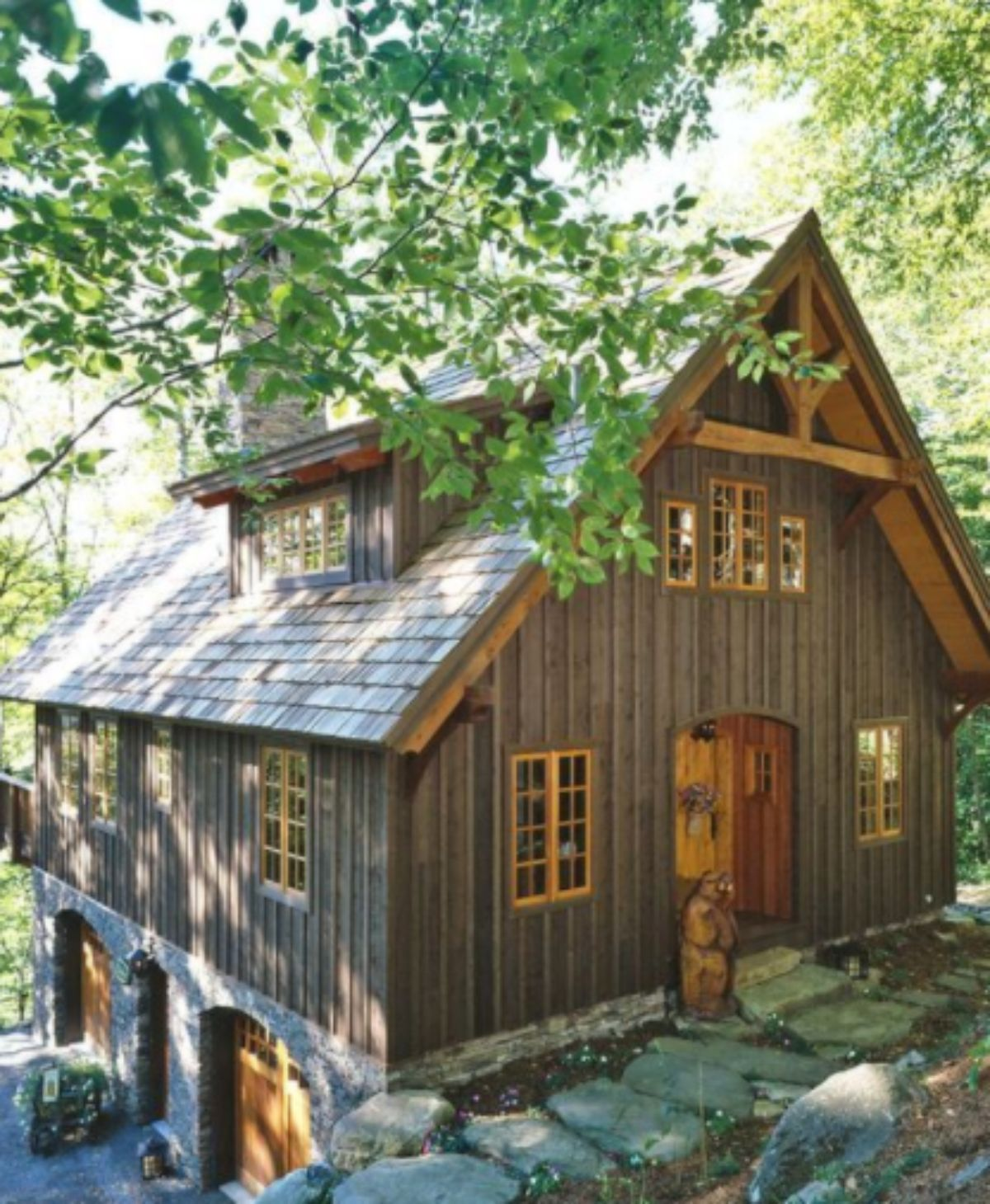 large log cabin with a garage