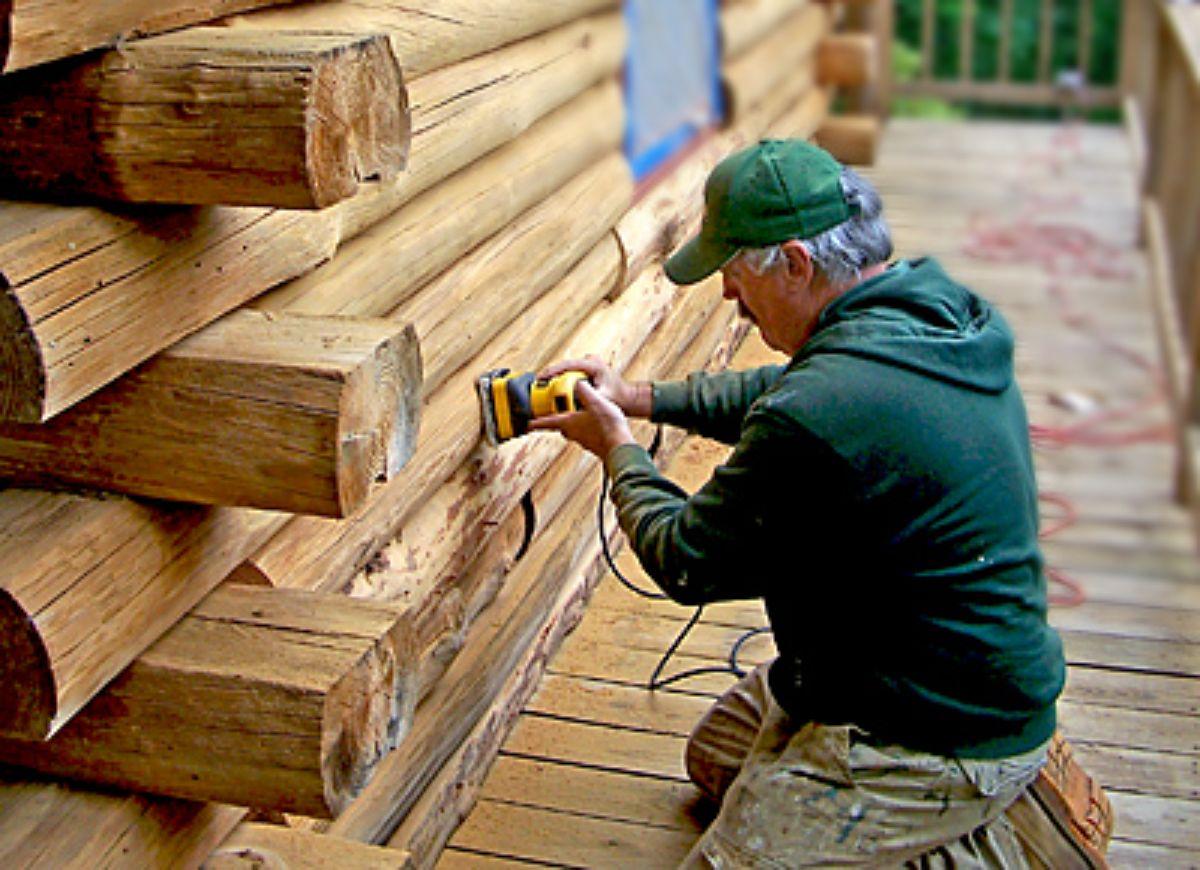 Carpenter doing Log Cabin Repairs