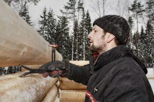 Man using log scriber
