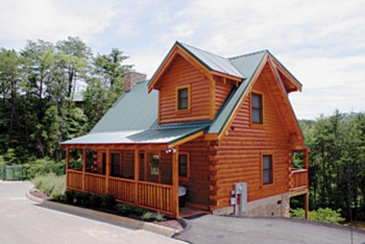 log cabin on hill