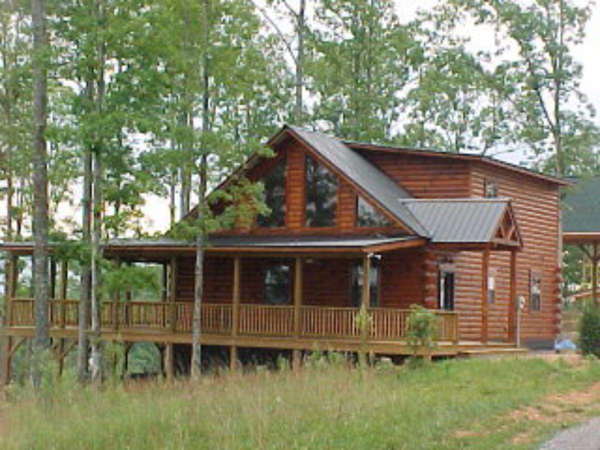 Log cabin in grass