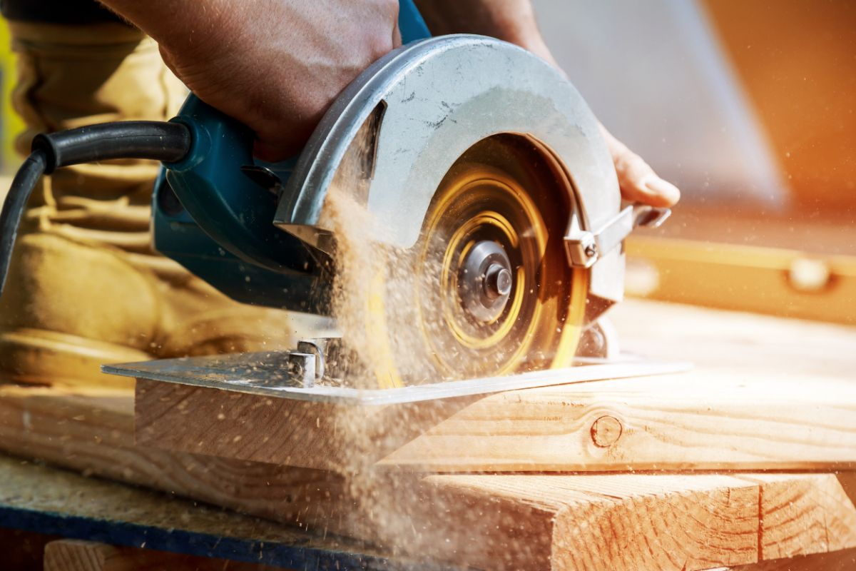 closeup of a log being cut by a saw