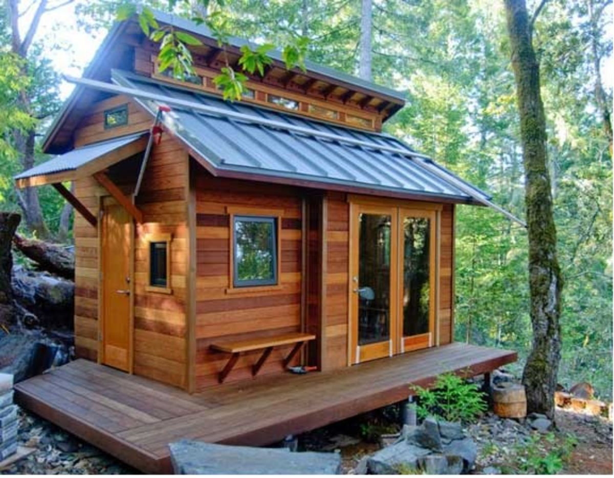 Small log cabin in woods